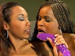 Two gorgeous black lesbians dildoing each second choice hard