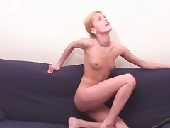This sultry and cute blonde on every side women's knickers is fingering her pussy